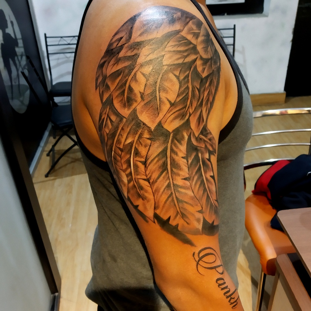 wings tattoo, wings tattoo for men